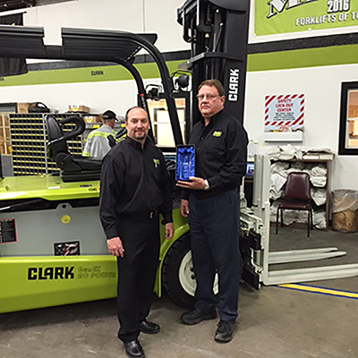 Forklifts of Toledo Service Manager gets award from Clark